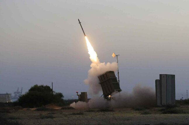 In this file photo taken July 5, 2014, an Iron Dome air defence system fires to intercept a rocket from Gaza Strip in the coastal city of Ashkelon, Israel.