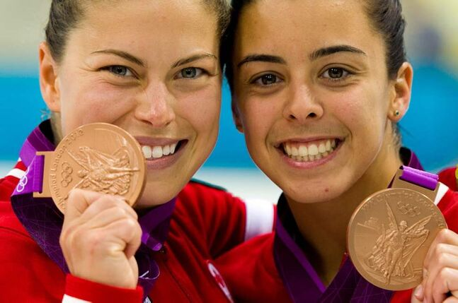 Canada's Roseline Filion and Meaghan Benefeito celebrate bronze medal finish in the women's synchronized 10-metre platform finals at the 2012 Summer Olympics. (The Canadian Press / Sean Kilpatrick)