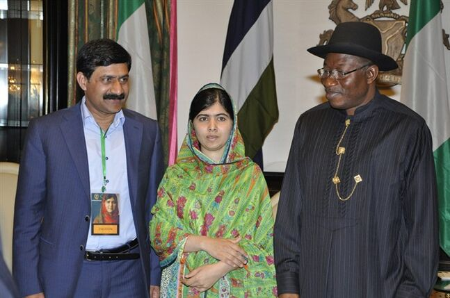 Pakistani activist Malala Yousafzai, centre, poses for a photo with her father Ziauddin left, and Nigerian President, Goodluck Jonathan, at the Presidential villa, in Abuja, Nigeria, Monday, July 14, 2014. Malala Yousafzai won a promise from Nigeria's leader to meet with the parents of some of the 219 schoolgirls held by Islamic extremists for three months. Malala celebrated her 17th birthday on Monday in Nigeria with promises to work for the release of the girls from the Boko Haram movement. (AP Photo)