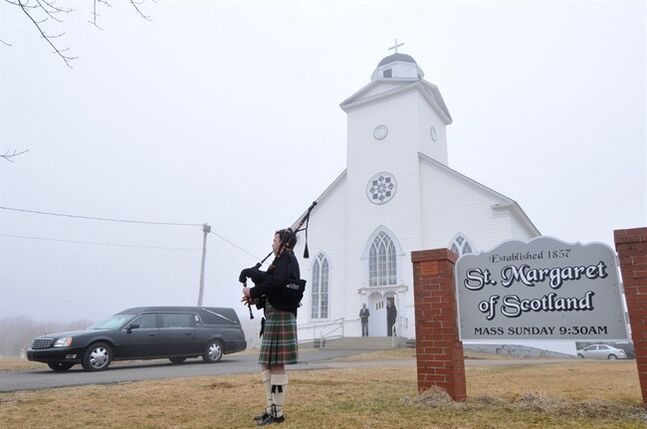 Piper Kenneth MacKenzie greets the funeral procession for the late Alistair MacLeod at St. Margaret of Scotland Church in Broad Cove, N.S., on Saturday, April 26, 2014. A funeral mass for writer Alistair MacLeod on Saturday resembled one of his meticulously crafted stories, blending well-chosen words, Celtic lament and insights into a life. About 300 people filled the 167-year-old St. Margaret of Scotland Roman Catholic Church in Broad Cove, N.S., near his summer home in Dunvegan, for the ceremony and burial in the neighbouring graveyard. THE CANADIAN PRESS/Vaughan Merchant