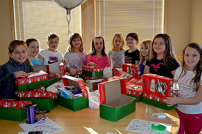 Arielle O., Brooke E., Sydney P., Ashley D., Ella D., Carmyn D., Allie K., Lindsay H., Alexandra S., Amy D. of the East St. Paul Dynamite U10 novice ringette team recently spent a day packing shoeboxes full of gifts for Operation Christmas Child.