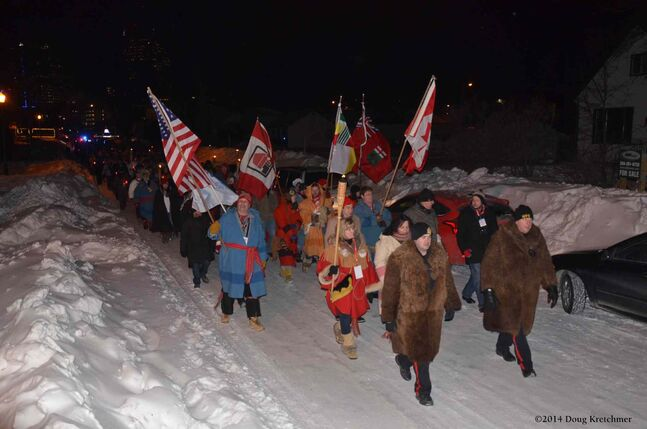 The torchlight March, led by police officers in buffalo fur coats, began at The Forks and went all the way to St. Boniface Cathedral and the grave of Louis Riel before ending at Voyageur Park.