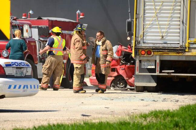 Two people were killed in a crash involving car and a semi trailer hauling hogs at the intersection of Highways 1 and 16 Wednesday afternoon.