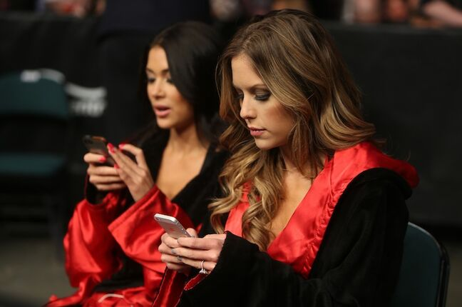 Octagon girls Arianny Celeste and Brittney Palmer keeping busy during UFC 161.