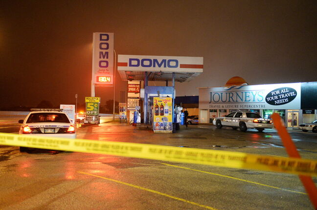 Police blocked off the Domo gas station at 317 Wardlaw Ave., after a shooting. Sarah Taylor / Winnipeg Free Press