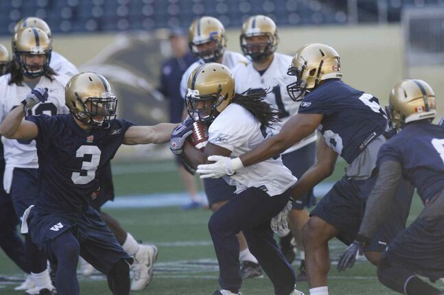 Winnipeg Blue Bomber #34 running back Paris Cotten with the ball at the team practice at Investors Group Field.