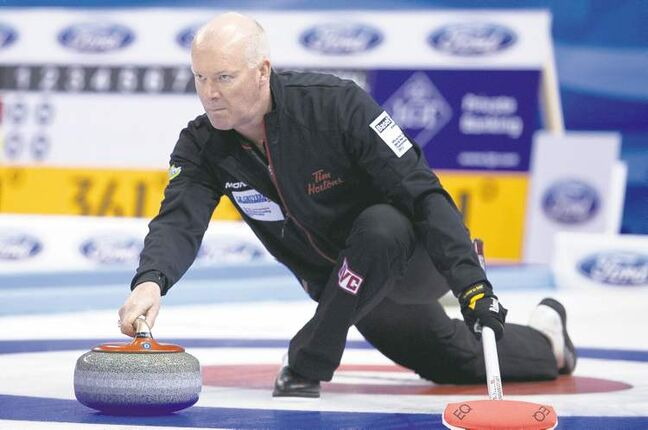 Canada skip Glenn Howard delivers a stone during a round-robin game against France at the world men's curling championship in Basel, Switzerland, Saturday.