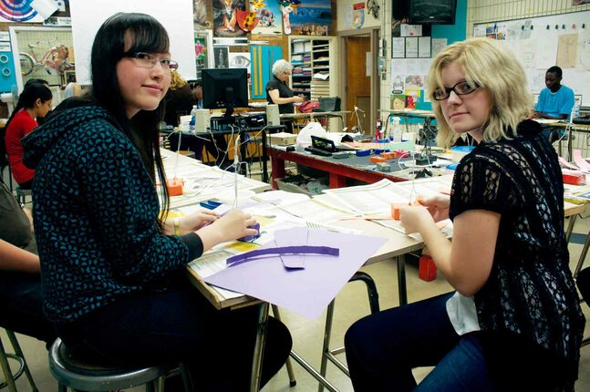 Kildonan-East Collegiate Grade 10 students Theora Patterson and Tania Wiebe are shown working on sculptures during teacher Angel Audrey's art class.