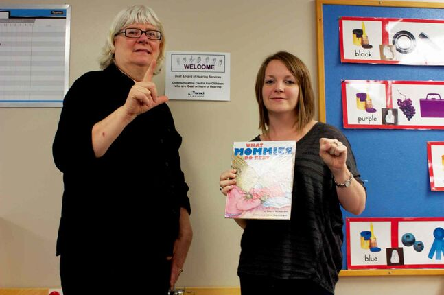 Sign-a-Story attendee Rita Bomak is shown with program organizer Cathy Grafton of the Society for Manitobans with Disabilities.