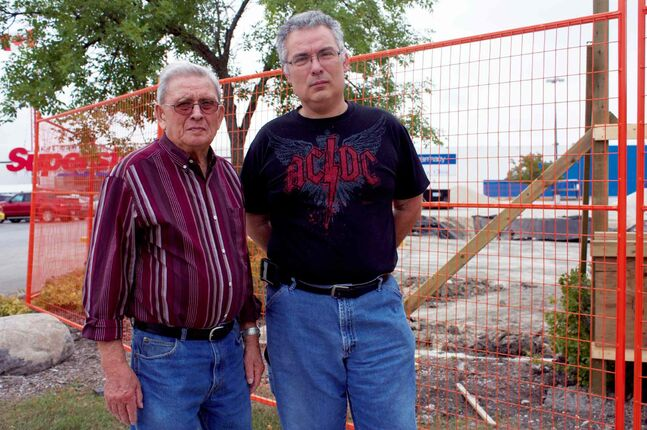 Roger Demelo (right) and his father, John, are concerned about the construction of the new Superstore gas bar on Gateway Road.