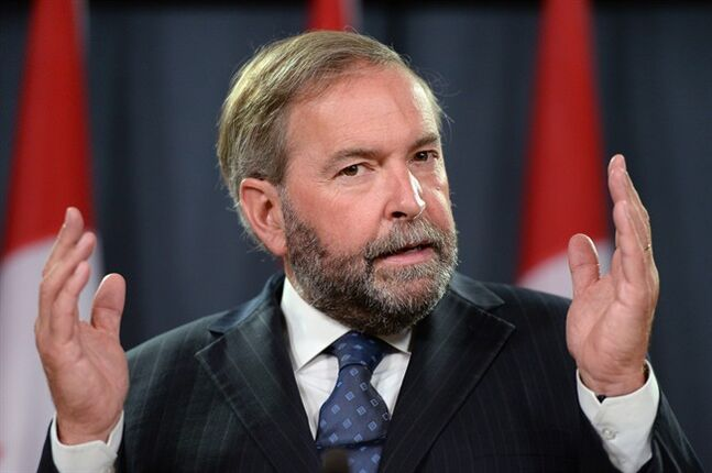 NDP leader Thomas Mulcair speaks a press conference at the National Press Theatre on Wednesday, Aug 27, 2014, to discuss the need for an inquiry on missing and murdered indigenous women. THE CANADIAN PRESS/Sean Kilpatrick