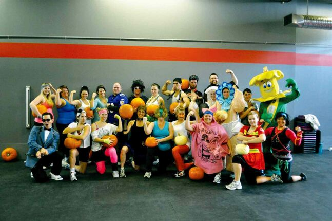 Participants in a previous Pumpkin Charity Workout are shown.