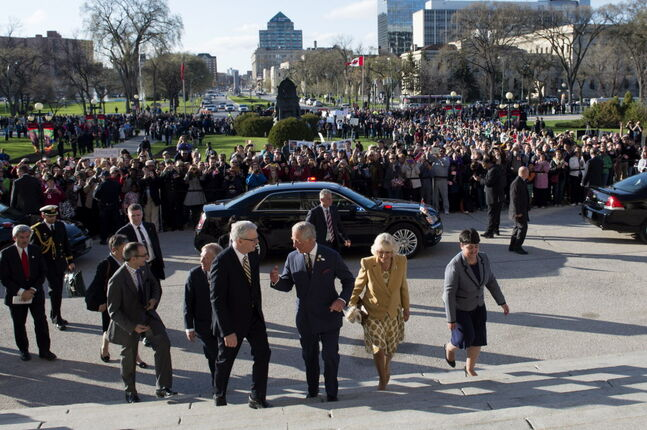 Prince Charles and his wife Camilla arrive at the Manitoba Legislature for the Order of Manitoba ceremony Wednesday.