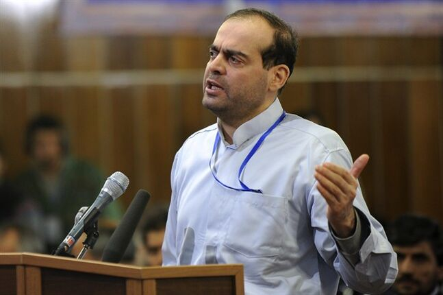In this picture Feb. 18, 2012 photo, released by the Iranian Students News Agency, ISNA, Mahafarid Amir Khosravi speaks at his trial in a court in Tehran, Iran. Khosravi, a billionaire businessman at the heart of a $2.6 billion state bank scam, the largest fraud case since the country's 1979 Islamic Revolution, was executed Saturday, state television reported. Authorities put Mahafarid Amir Khosravi, also known as Amir Mansour Aria, to death at Evin prison, just north of the capital, Tehran, the station reported. The report said the execution came after Iran's Supreme Court upheld his death sentence. (AP Photo/ISNA, Hamid Foroutan)