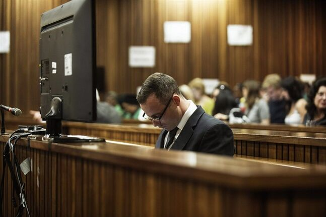 Oscar Pistorius sits in the dock in court in Pretoria, South Africa, Wednesday, May 14, 2014, as the judge overseeing his murder trial ordered him to undergo psychiatric tests, meaning that the trial proceedings will be delayed. The court adjourned until May 21, 2014. Pistorius is charged with murder for the shooting death of his girlfriend Reeva Steenkamp on Valentine's Day in 2013. (AP Photo/Gianluigi Guercia, Pool)
