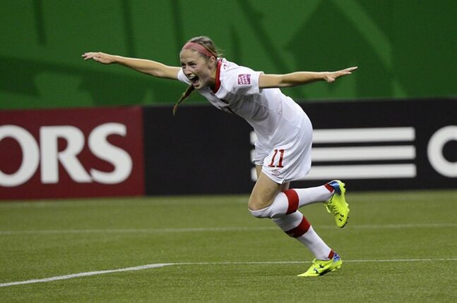 Canada's Janine Beckie celebrates after scoring against North Korea during second half FIFA U20 Women's World Cup soccer action Tuesday, August 12, 2014 in Montreal. THE CANADIAN PRESS/Paul Chiasson