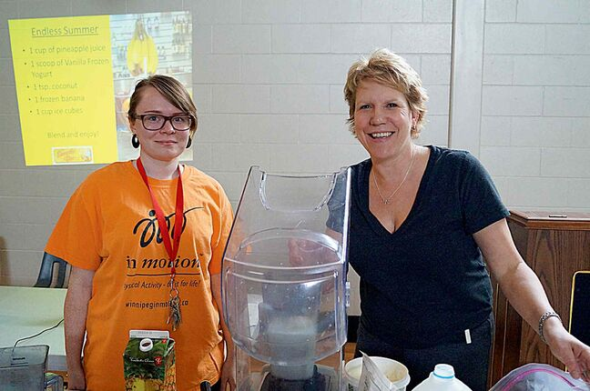 Vanessa McLean of Good Neighbours Active Living Centre and Jackie Friesen of Smoothie Bar prep smoothies for participants in the centre's spring health fair.