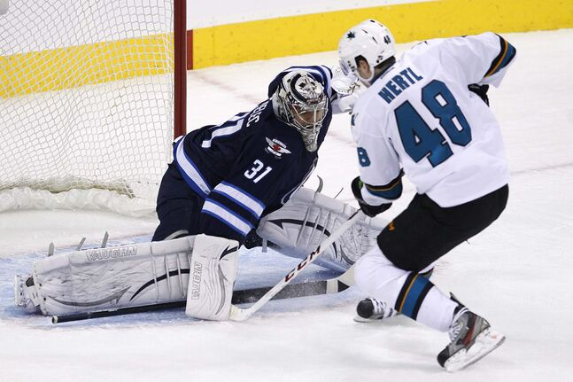 San Jose Sharks' Tomas Hertl (48) scores on the breakaway against Winnipeg Jets' goaltender Ondrej Pavelec (31) during the first period.