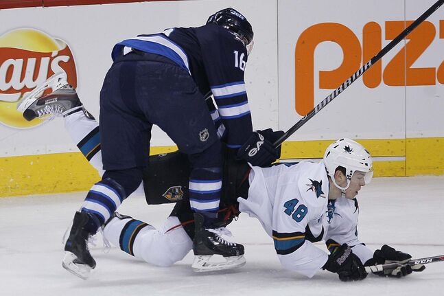 Winnipeg Jets' Andrew Ladd (16)¤checks San Jose Sharks' Tomas Hertl (48) during the first period.