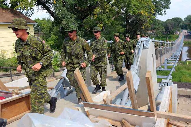 Soldiers from the 2nd Battalion, Princess Patricia's Canadian Light Infantry, seen here marching over the newly constructed Souris Swinging Bridge recently, will conduct a Freedom of the City parade and ceremony Friday morning in Winnipeg.