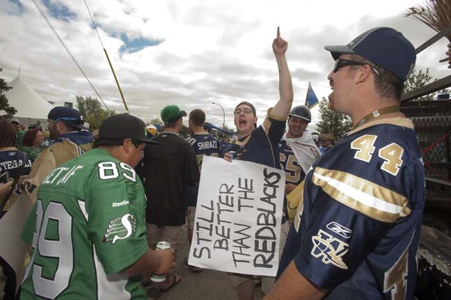 CFL fans show their colours prior to the Labour Day classic game between the Winnipeg Blue Bombers and the Saskatchewan Roughriders in Regina, Sask., Sunday, September 01, 2013.
