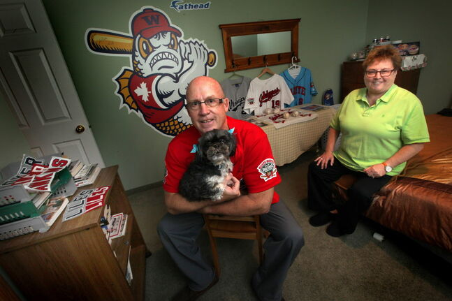 Bruce and Linda Ward, a billet family that hosts Goldeye players, sit in the basement bedroom they provide.