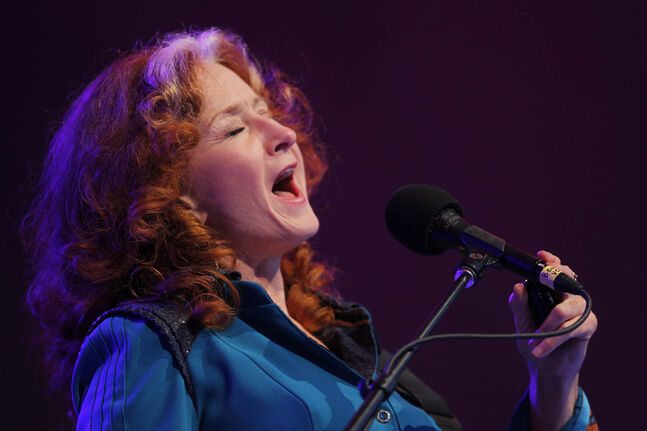 Bonnie Raitt headlining the main stage on Wednesday evening.