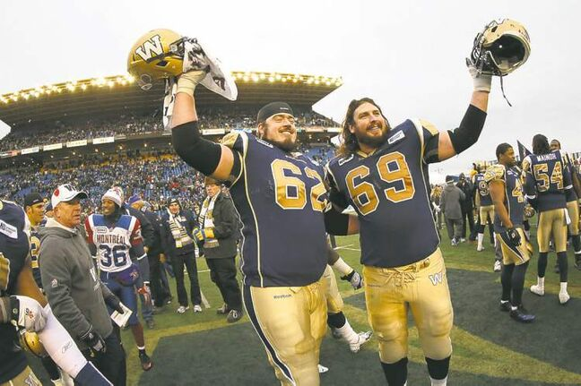 Winnipeg Blue Bombers' Steve Morley (62) and Glenn January (69) salute the crowd following the teams victory in the final game at Canad Inns Stadium, Saturday, November 3, 2012.