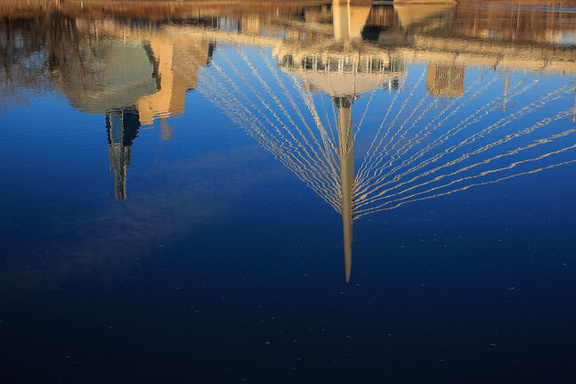 The Canadian Museum for Human Rights and the Esplanade Riel reflected in the Red River. Day 20. (MELISSA TAIT / WINNIPEG FREE PRESS)