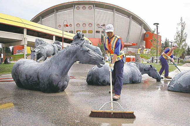 Cleanup crews hard at work getting the Calgary Stampede grounds ready Monday.