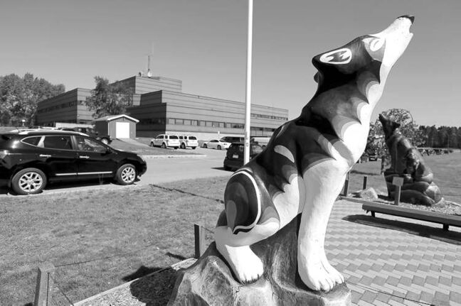 Two of Thompson's pack of 52 mural-covered wolf statues howl outside the Provincial Building.