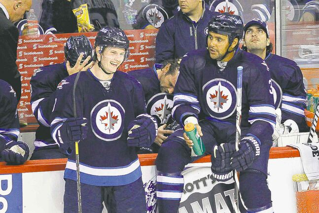 Winnipeg Jets Jacob Trouba (left) and Dustin Byfuglien joke around during a commercial break on Thursday night.