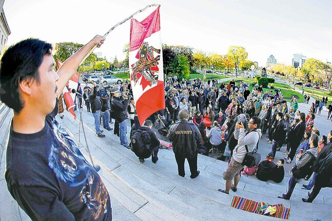 A crowd surrounds a drum circle at the foot of the steps of the Manitoba legislature Monday.