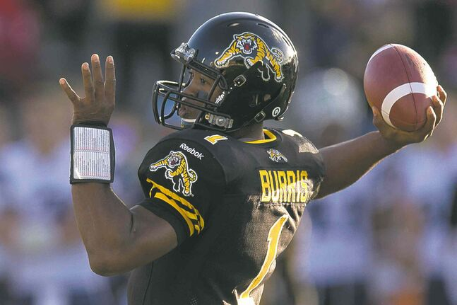 Tiger-Cats quarterback Henry Burris launches a pass against the Argonauts Monday.