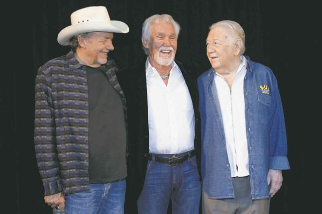 From left, Bare, Rogers and Clement last April. Clement died in August.