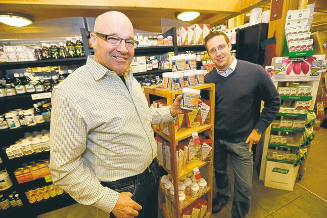 John Hare (left), with Vita Health Fresh Market president Mathew Holtmann, holds a container of Gastro Aid Plus.