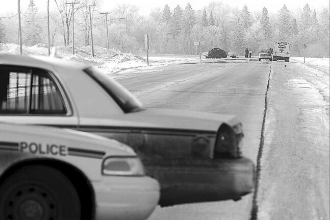Police investigate an accident south of the floodway on St. Mary's Road.
