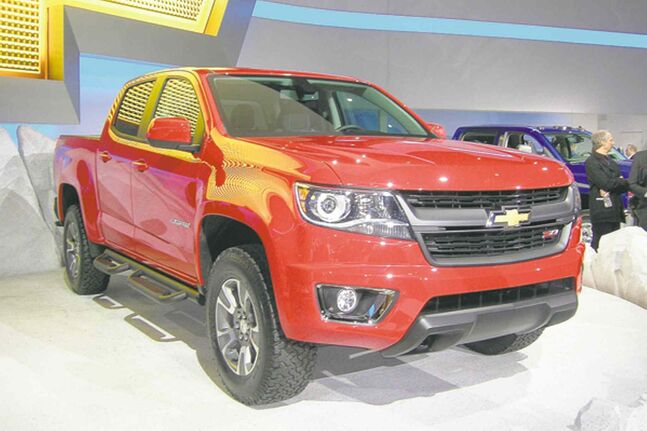 General Motors unveiled the new Chevrolet Colorado, left, last month at the Los Angeles auto show.