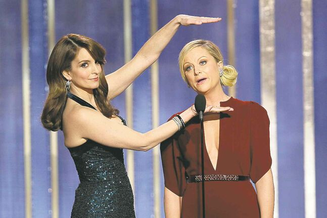 Co-hosts Tina Fey, left, and Amy Poehler at the 2013 Golden Globes