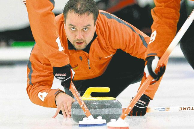 Richard Daneault throws a stone in the Asham final of the Manitoba Open at the Assiniboine Memorial Curling Club on Monday.