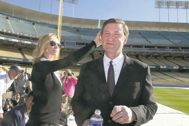 Wayne Gretzky and wife Janet check out Dodger Stadium before the NHL Stadium Series game in Los Angeles.