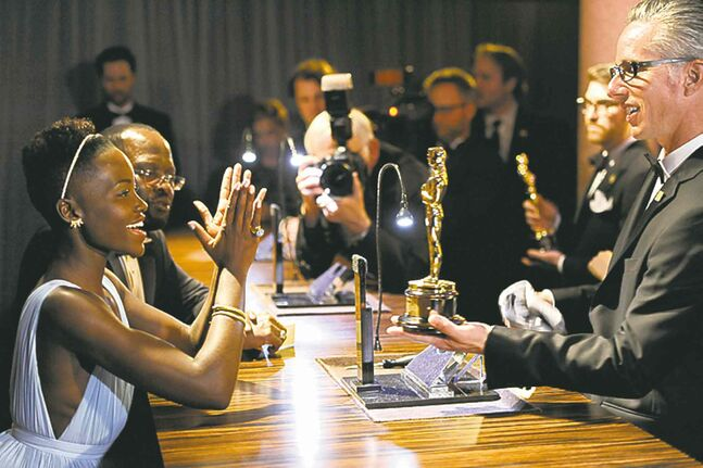 Lupita Nyong'o, winner of the award for best actress in a supporting role in the movie 12 Years a Slave, applauds after getting her award engraved at the Governors Ball after the Oscars last Sunday.