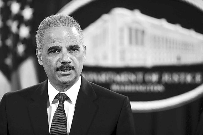 At a May 19 news conference, U.S. Attorney General Eric Holder announces a grand jury has charged five Chinese hackers with economic espionage and trade-secret theft.