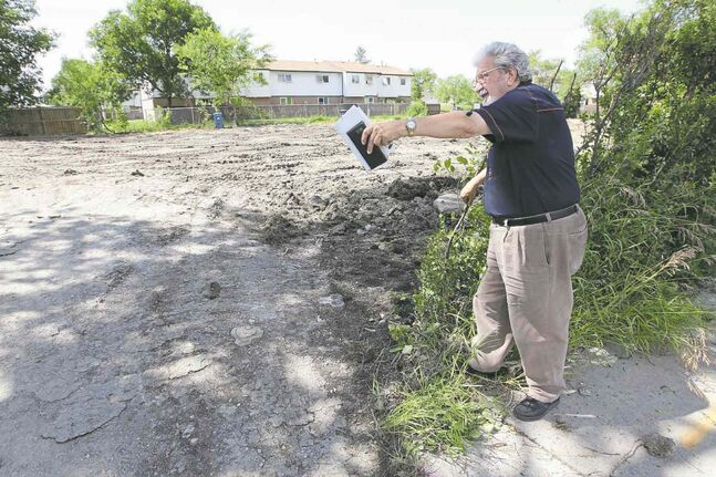 Steve Miloica stands near the vacant lot  where his home was once located.