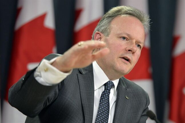 Bank of Canada Governor Stephen Poloz gestures during a news conference in Ottawa, Wednesday, Jan.22, 2014. THE CANADIAN PRESS/Adrian Wyld