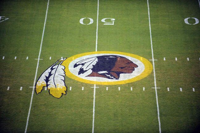 The Washington Redskins logo on the field before he start of a preseason NFL football game in Landover, Md, in a file photo. The team's name, which some consider a derogatory term for Native Americans, has faced a barrage of criticism.