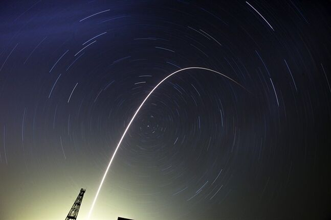 The Soyuz-FG rocket booster with Soyuz TMA-13M space ship carrying a new crew to the International Space Station, ISS, flies in the sky at the Russian leased Baikonur cosmodrome, Kazakhstan, Thursday, May 29, 2014. Circular star tracks around the Polar Star and track of the rocket a the result of the long time exposure. (AP Photo/Dmitry Lovetsky)