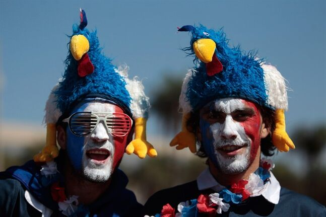 France soccer fans, with their faces painted with their team's colors arrive at the National Stadium to watch World Cup round of 16 match against Nigeria, in Brasilia, Brazil, Monday, June 30, 2014. France's Paul Pogba scored with a late header to finally break Nigeria's stubborn resistance and Joseph Yobo scored an own-goal as France won 2-0 to reach the World Cup quarterfinals on Monday. (AP Photo/Eraldo Peres)