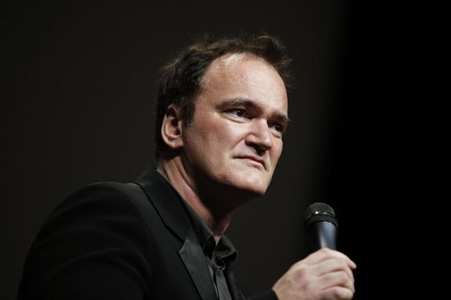 FILE - In this Oct. 18, 2013 file photo, director Quentin Tarantino delivers a speech before receiving the Lumiere Award during the 5th edition of the Lumiere Festival, in Lyon, central France. Tarantino sued Gawker Media LLC on Monday, Jan. 27, 2014, in Los Angeles for copyright infringement over the site's posting of a story that linked to a leaked copy of his script for a planned film called