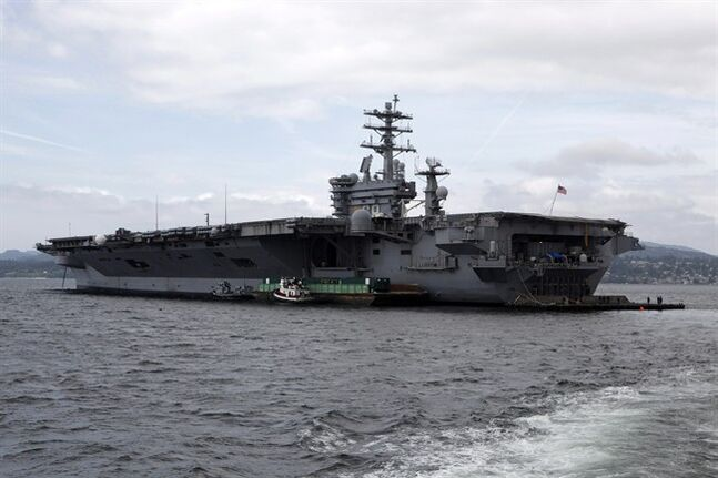 USS Nimitz, a 23-storey-tall, 1,115-foot nuclear-powered aircraft super carrier of the United States Navy anchors in the Juan de Fuca Strait Saturday, June 14, 2014 in Victoria, B.C. THE CANADIAN PRESS/Chad Hipolito